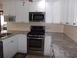 kitchens with white cabinets and black appliances kitchen ideas with white cabinets and black appliances therobotechpage