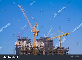 four towers crane on top construction stock photo 228674023