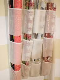 christmas paper storage 10 ways to organize your wrapping paper and gift bags hgtv