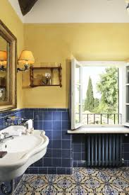 a tuscan bathroom at hotel borgo san felice in castelnuovo