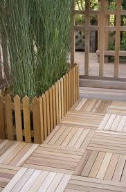 Wooden Patio Decks by Best 25 Wood Deck Tiles Ideas Only On Pinterest Rooftop Deck