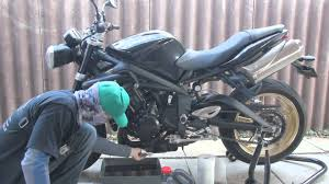 how to change the oil in a motorcycle triumph street triple r