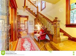 Bright Red Sofa Bright Hallway With Colourful Rug Nice Red Sofa Wooden Stairca