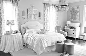 bedroom storage ottoman and bedding with chandelier also curtain