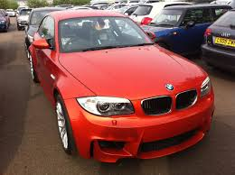 uk customer takes delivery of bmw 1m valencia orange