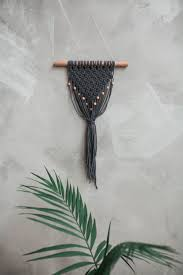 macrame wall hanging on an oak stick dark grey color cotton