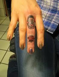 rose and matryoshka ring tattoo