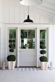 pleasurable front door exterior home deco contains strong wooden board and batten door design entry style with topiary