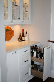 frosted white glass subway tile liquor bottles cabinet design