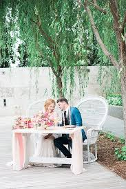 bride and groom sweetheart table bride groom sweetheart table with wicker peacock chair at modern