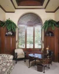 decorating castle sunburst shutters in brown on cream wall