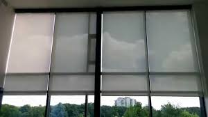 two story tall motorized shades with somfy and savant integration