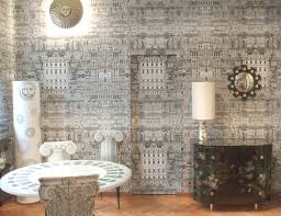 fornasetti riflesso in milan showroom wallpaper by cole u0026 son