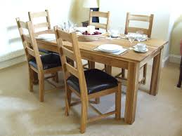 solid oak dining table uk wood room sets canada chairs for sale