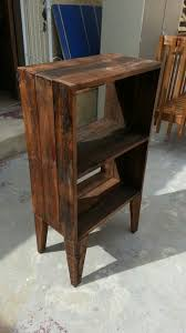small stand alone cupboard made out of old pallet wood and