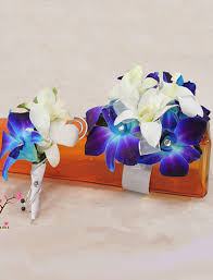 blue orchid corsage corsage bout white and blue orchids cherry blossoms florist