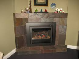 valor legend g3 739jln gas fireplace insert installed in corner masonry fireplace with custom tiled