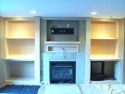 tv above fireplace a storage mounting flat screen mantel with finish carpentry contractor stand