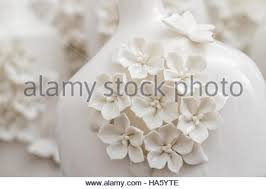 different decorative white vases with 3d flower and butterfly