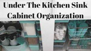 how to organize under the kitchen sink cabinet youtube