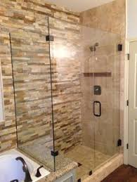 clean mordern glass shower doors with slate tile like the bench
