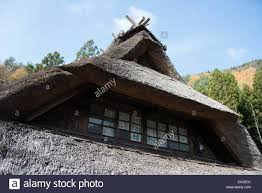 traditional japanese house with thatched roof at oishi petit
