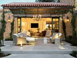 Outdoor Living Spaces Showing Rattan Chair On Rug