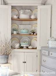 14 ways to decorate like a french woman white dishes cupboard
