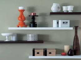Staggered Bookshelves by Floating Wall Shelves To Use In Decorating Your Home Minimalist
