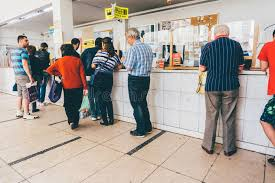 Post Office Casual Waiting In Line At The Post Office Stock Photo Image Of