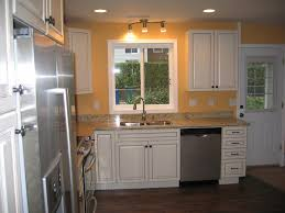 kitchen window trim design with white wooden kitchen cabinet and