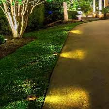 pathway well light with tri directional brass cover aqlighting