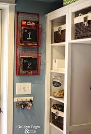wire basket in mudroom entryway for storage of stuff that needs to