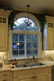 Over Kitchen Sink Light by Arched Window Over Kitchen Sink Google Search Kitchen Sink