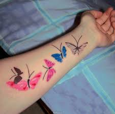 check out colored butterfly tattoos on left forearm we curate the