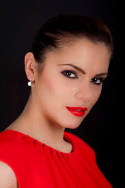 portrait of a beautiful woman with red lipstick and red dress