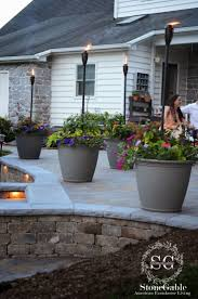 stone patio as patio heater for easy backyard patio ideas on a