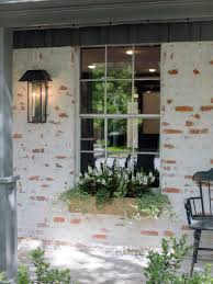 fixer upper old world charm for newlyweds bricks exterior and