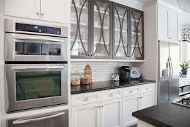 white kitchen cabinet with glass doors how to style the glass cabinet doors in your kitchen designed
