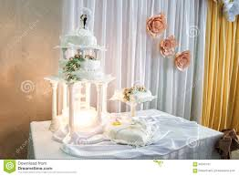 wedding cake decoration of champagne fountain in lights and wedd