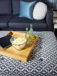 turn an old coffee table into an upholstered storage ottoman hgtv