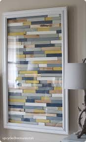 painted wood artwork diy paint stick craft ideas that are borderline genius 18