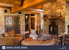 leather chairs next four sided natural stone fireplace wine cellar