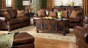 traditional living room with brown leather ottoman designs decor
