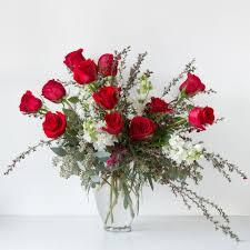 a dozen roses a dozen roses green florist