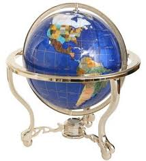 blue lapis gemstone world globe on a curved stand with compass