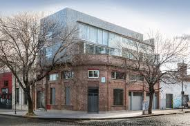 multifamily multifamily building and store risso carasatorre risso archdaily