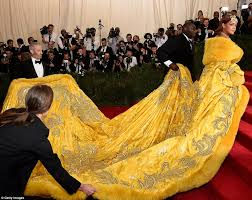 rihanna dons huge bright yellow gown for chinese themed met gala
