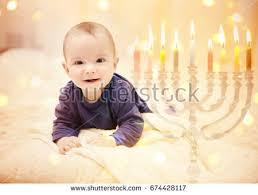 hanukkah baby child on blurred festive lights stock photo 674428117