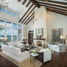 living room with vaulted ceiling beach style piggy banks living room contemporary with piithced